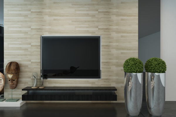 Wall mounted TV in a modern living room interior with topiary potted trees, African masks and a feature textured wall in an architectural background, 3d render